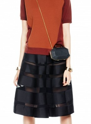 Transition from spring to fall with a midi skirt and wide brimmed hat