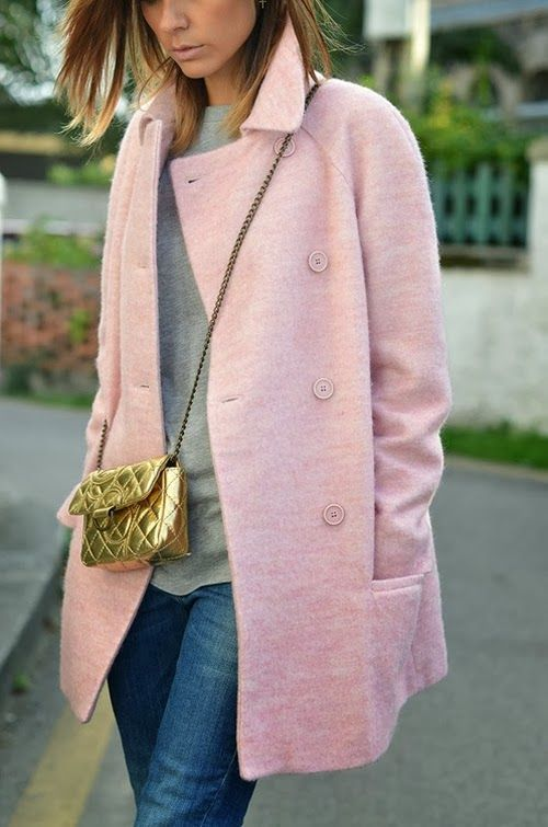 Throw a pink coat over staple jeans and a grey sweater